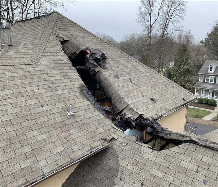 hole in roof caused by fire