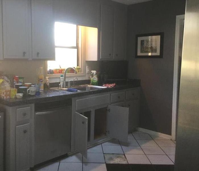 Home in Sandy Plains Sustains Water Damage in Kitchen Before
