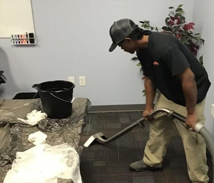 SERVPRO technician extracting water